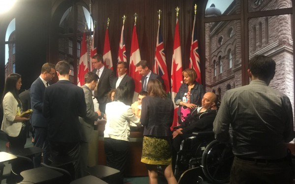 The Personal Injury Alliance (PIA Law), Brain Injury Society of Toronto (BIST), and Spinal Cord Injury Ontario (SCI Ontario) gather at Queen's Park to discuss auto insurance reform. (Photo Credit: Omar Ha-Redeye)