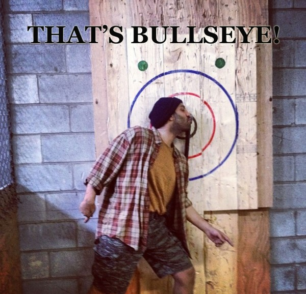 Omar Ha-Redeye at a bachelor party in 2014, throwing axes as a lumberjack. Slightly more liability here, but also quite a bit more volenti.