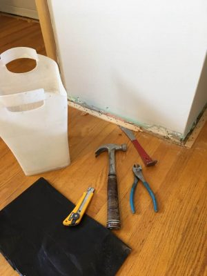 Garbage can small pry-bar and box cutter and bag, hammer, side cutters,